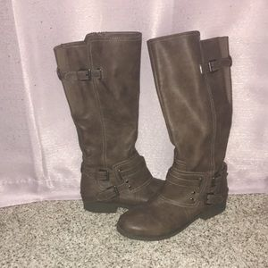 Brown boots with buckle decorations
